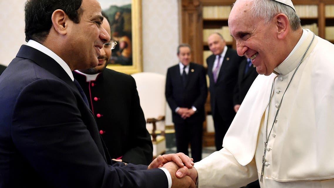 ROM1772 - Vatican City, -, VATICAN CITY STATE :  Pope Francis (R) shakes hands with Egypt's President Abdel Fattah al-Sisi (L) at the end of their meeting at the Vatican on November 24, 2014. AFP PHOTO / GABRIEL BOUYS