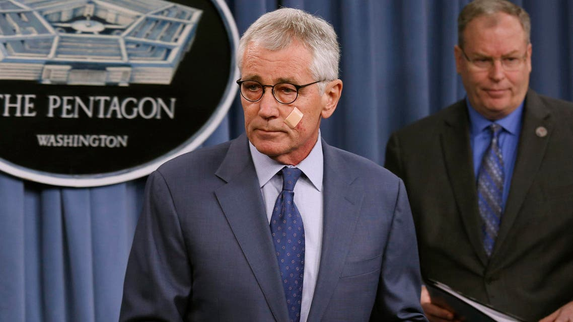U.S. Secretary of Defense Chuck Hagel (L) leaves next to Deputy Secretary of Defense Bob Work after a news briefing to announce reforms to the nuclear enterprise at the Pentagon in Washington, November 14, 2014.  (Reuters)