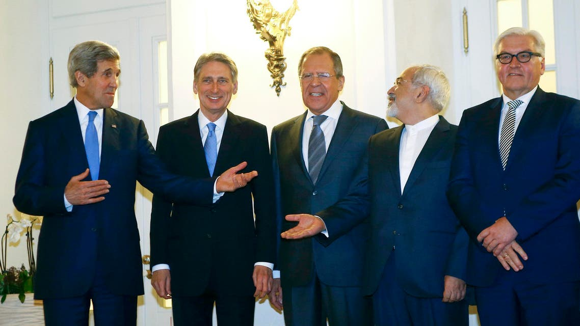 U.S. Secretary of State John Kerry, Britain's Foreign Secretary Philip Hammond, Russian Foreign Minister Sergei Lavrov, Iranian Foreign Minister Javad Zarif and German Foreign Minister Frank-Walter Steinmeier (L to R) pose for photographers before a meeting in Vienna Nov. 24, 2014. (Reuters)