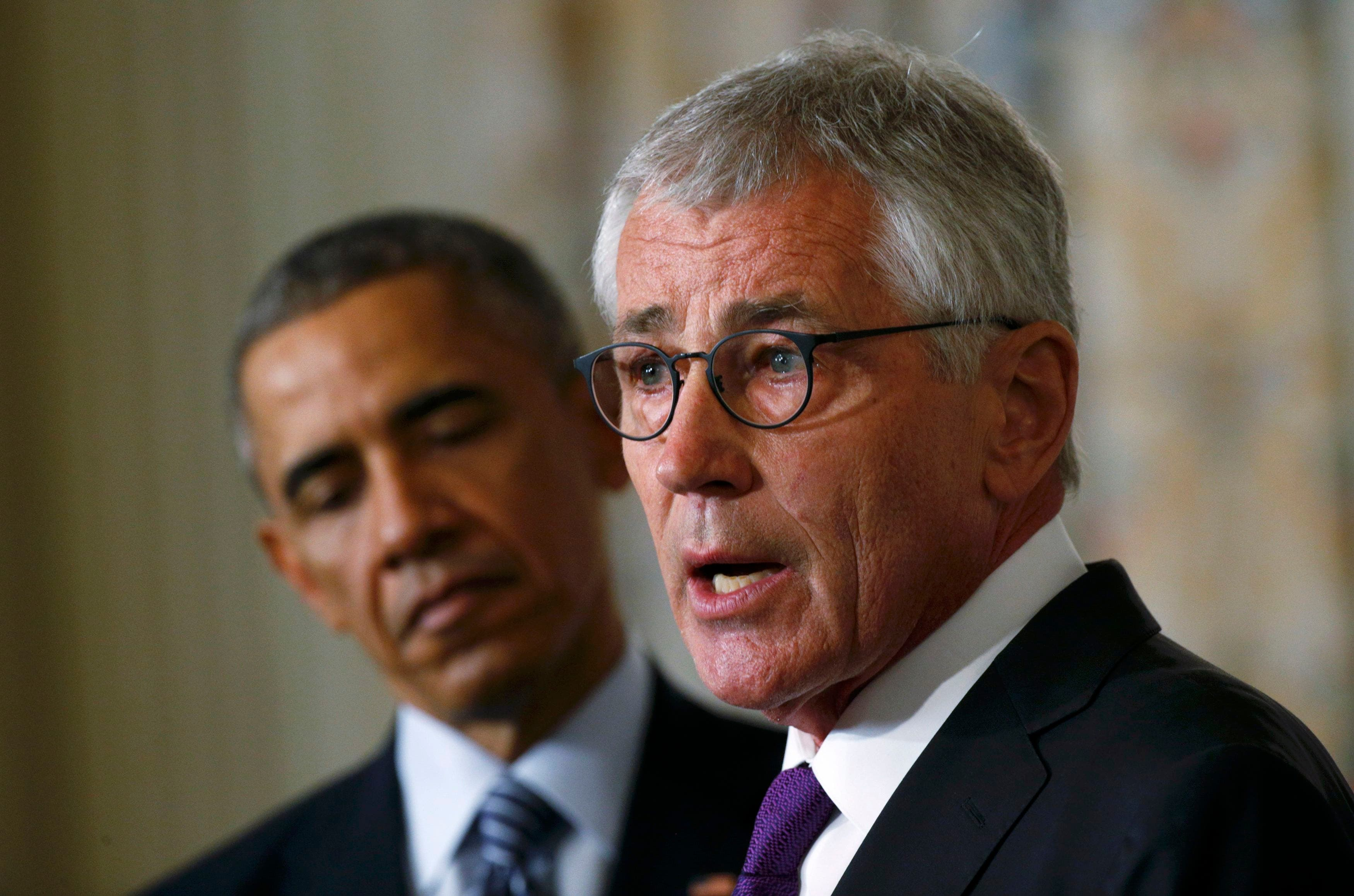U.S. President Barack Obama (L) listens to Defense Secretary Chuck Hagel after the president announced Hagel's resignation at the White House in Washington, November 24, 2014. (Reuters)
