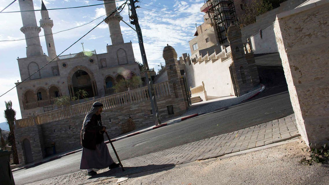 A man walks past a new mosque in the Israeli Arab village of Abu Ghosh, near Jerusalem in this November 22, 2013 file photo. (Reuters)