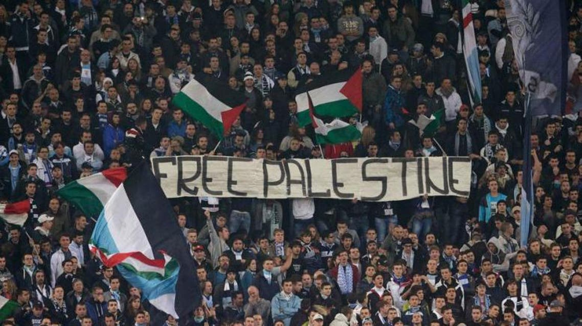 "SS Lazio's fans display a banner that reads, ""Free Palestine"" during the Europa League soccer match against Tottenham at the Olympic stadium in Rome 22 November 2012. (File photo: Reuters)"