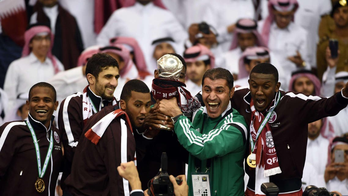Qatar players carry the Gulf cup trophy after defeating Saudi Arabia 2-1 in the final of the 22nd Gulf Cup football match at the King Fahad stadium in Riyadh, on Nov. 26, 2014. (Qatar)