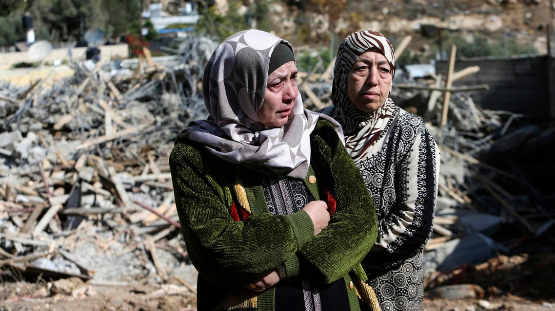 Palestinian Um Issam (L) stands with a relative near the rubble of her demolished house in the East Jerusalem neighbourhood of Abu Tor November 4, 2014. (Reuters)