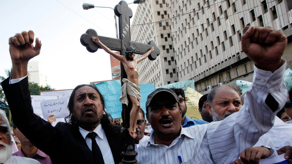 Members of the Pakistani Christian community chant slogans during a demonstration to condemn the death of a Christian couple in a village in Punjab province on Tuesday, in Karachi Nov. 6, 2014. (Reuters)