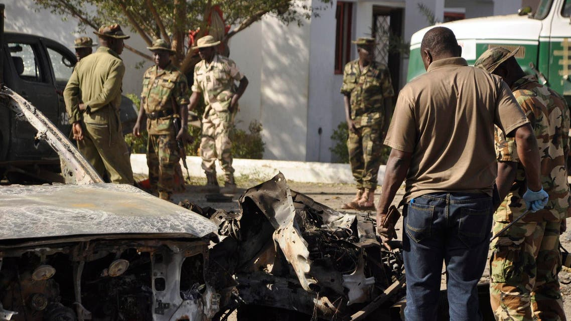 Bomb experts and military personnel investigate the site of an explosion at a police station in Kano November 15, 2014. A suicide bomber killed six people, including three policemen, in the northern city of Kano on Friday, a police spokesman said. There was no immediate claim of responsibility but Kano has often been the target of bombings by Boko Haram during their five-year-old campaign of violence. REUTERS