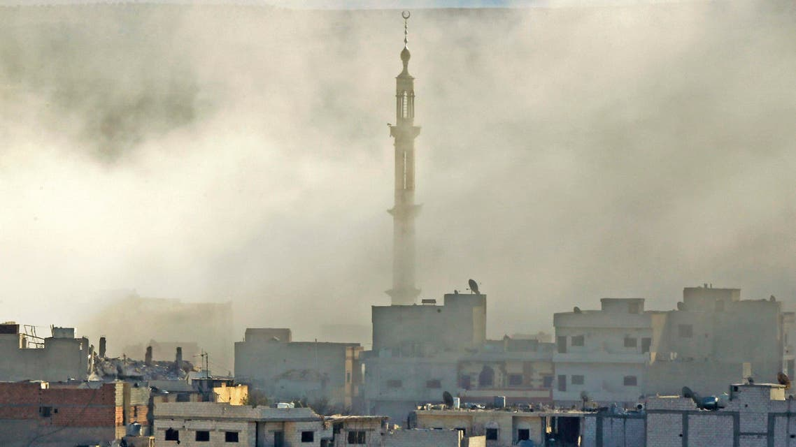 Thick smoke engulfs the minaret of a mosque following an air-strike in eastern Kobani on November 9, 2014. (Reuters)