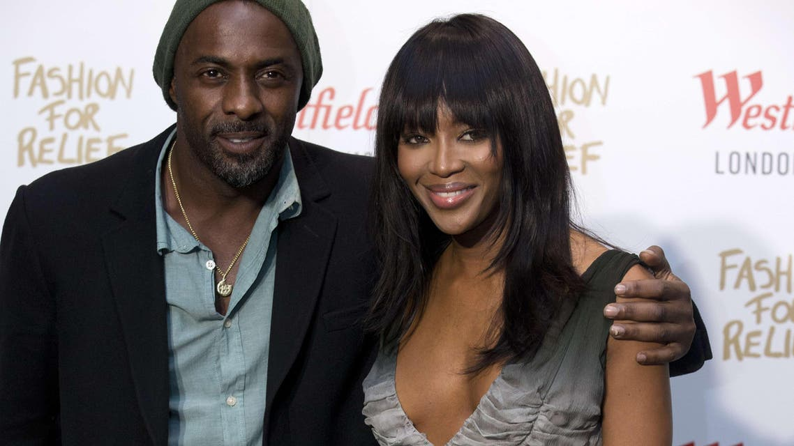 British supermodel Naomi Campbell (R) poses with British actor Idris Elba (L) at the launch of the Fashion For Relief Pop-Up at Westfield in London on November 27, 2014.