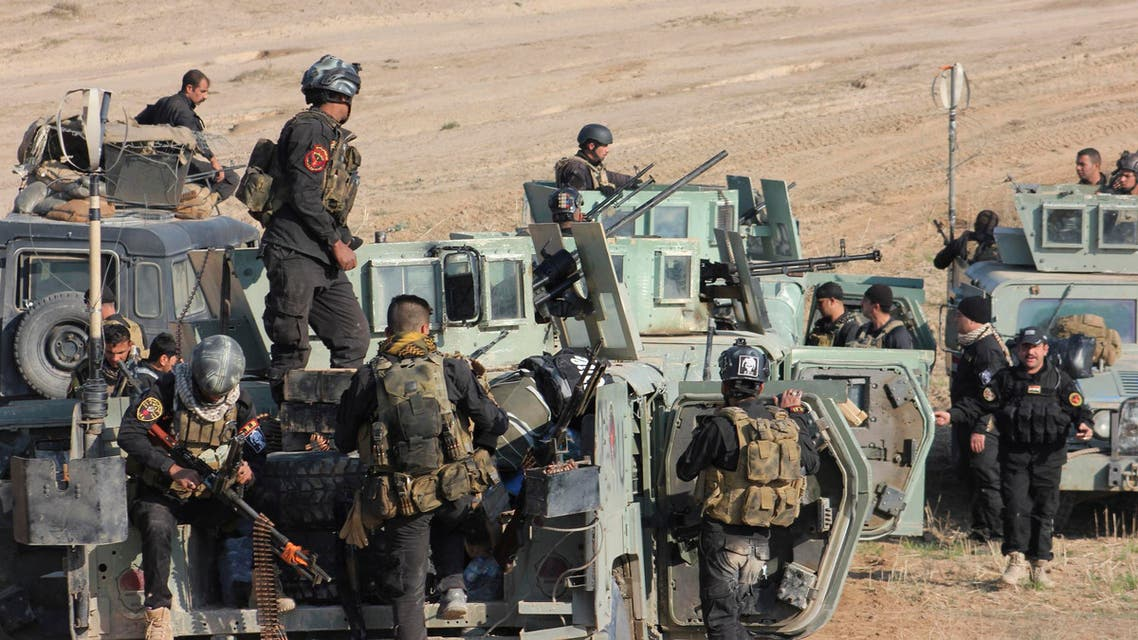 Members of the Iraqi security forces and Shi'ite fighters take part during an intensive security deployment in the town of Qara Tappa in Iraq's Diyala province November 26, 2014. (Reuters)