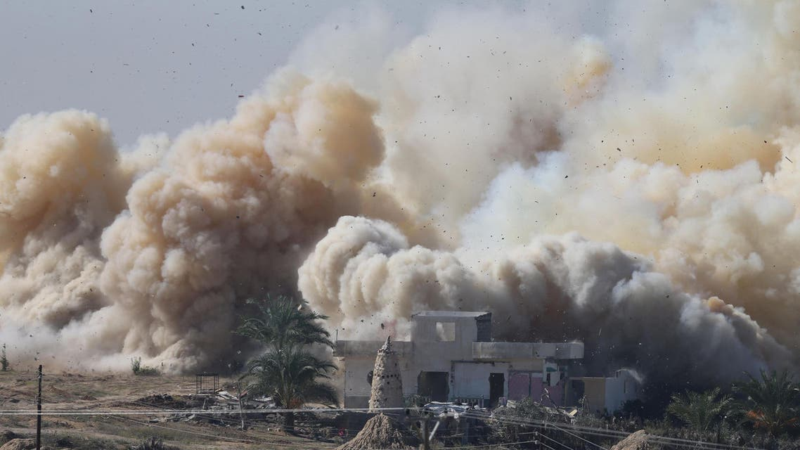 Smoke rises as a house is blown up during a military operation by Egyptian security forces in the Egyptian city of Rafah, near the border with southern Gaza Strip November 6, 2014.
