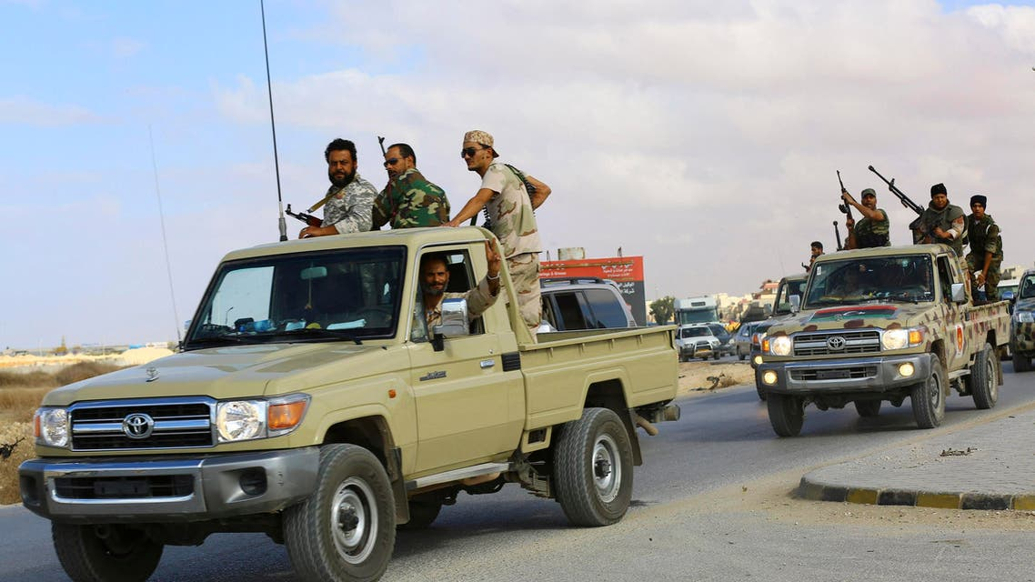 Forces loyal to former general Khalifa Haftar ride in vehicles in Benghazi November 20, 2014. (Reuters)