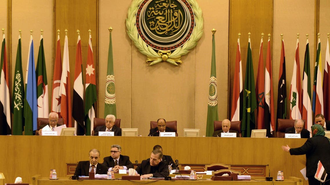 Palestinian president Mahmud Abbas (C-L) seen attending an extraordinary Arab League meeting to discuss the situation in the Palestinian territories, in Cairo on November 29, 2014. (AFP)