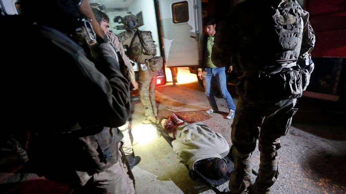 The dead body of a foreigner lies on the ground after a Taliban attack on a foreign aid workers' guest house in the Afghan capital of Kabul November 29, 2014.  (Reuters)