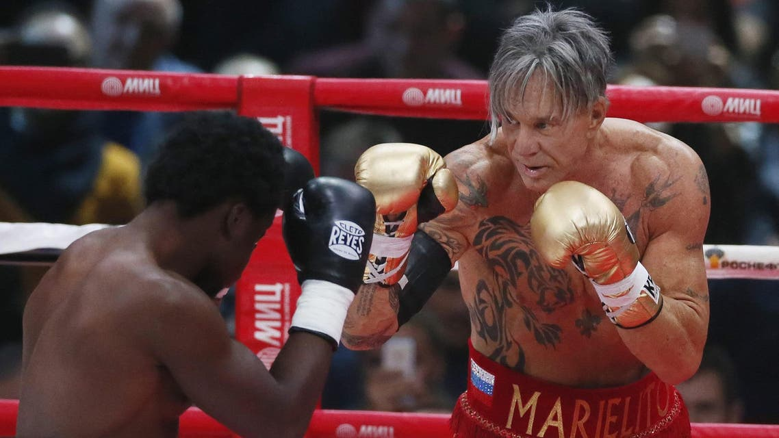 Mickey Rourke and his opponent during the match. (Photo courtesy: AP)