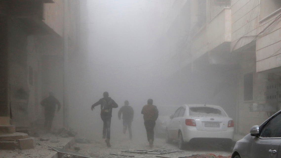 People run amid smoke from a site hit by what activists said were air strikes by forces loyal to Syria's President Bashar al-Assad in Raqqa, eastern Syria, which is controlled by the ISIS November 27, 2014. (Reuters)