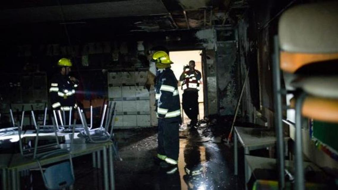 Emergency responders put out the fire which started in the school's playground. (Photo courtesy: Tali Meir/Haaretz)