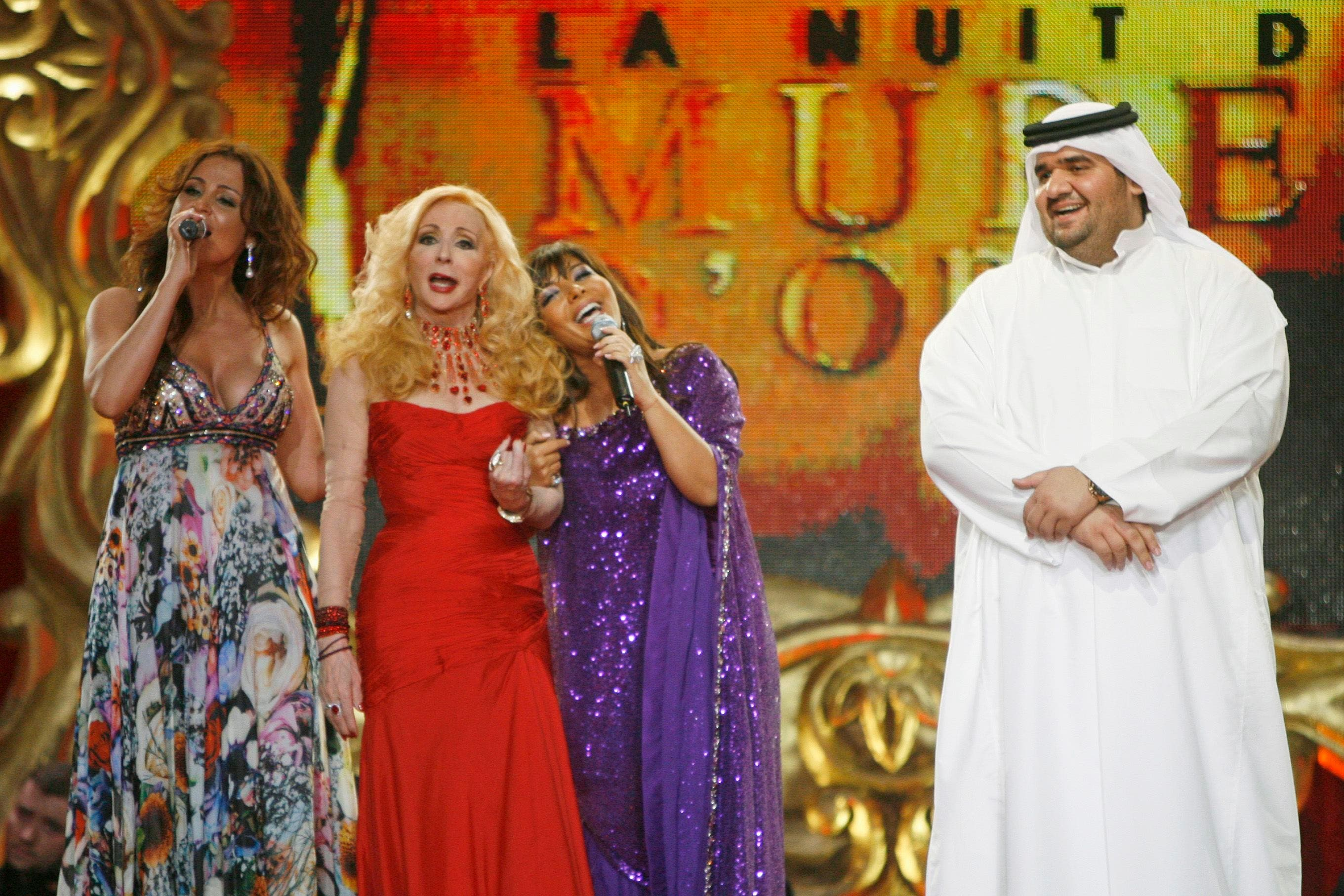 Lebanese singer Carole Samaha (L), Lebanse singer Sabah (2nd L), Syrian singer Asala (2nd R) and Emirati singer Hussein al- Jasmi (R) perfom at the Casino du Liban, north of Beirut, in this June 20, 2008 file photo. (Reuters)