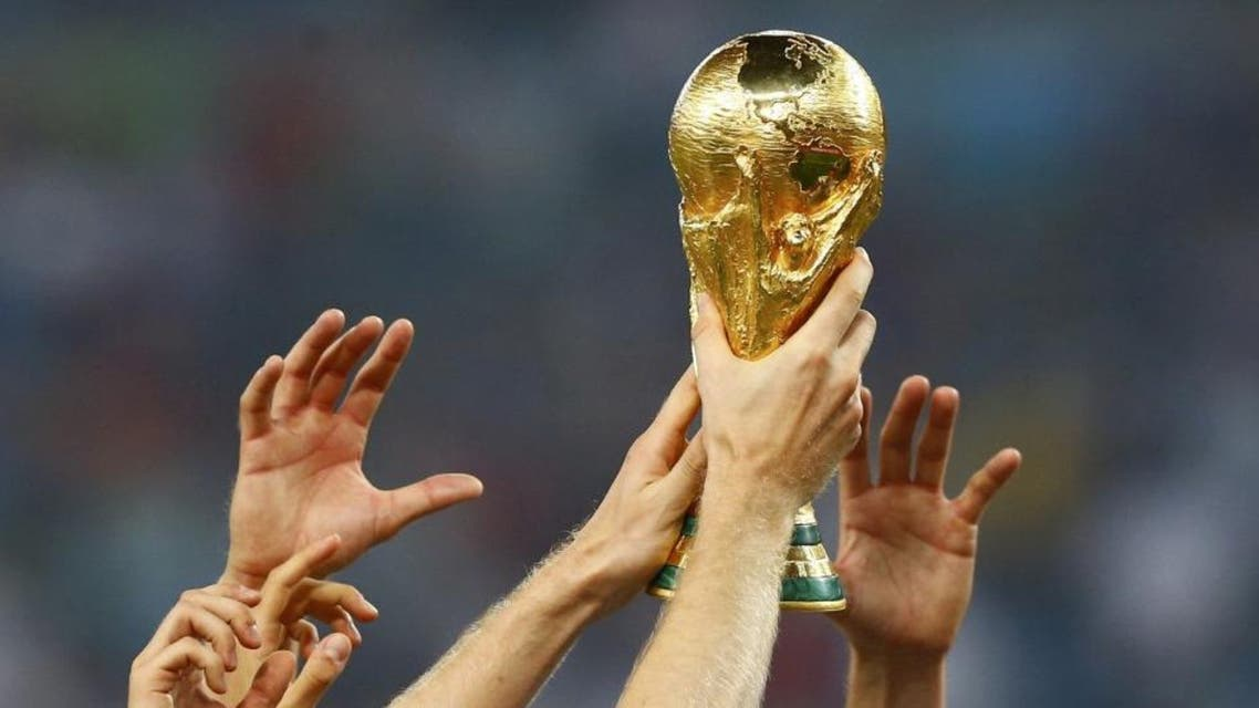 Germany's players hold up the World Cup trophy as they celebrate their 2014 World Cup final win against Argentina at the Maracana stadium in Rio de Janeiro July 13, 2014. (File Photo: Reuters)