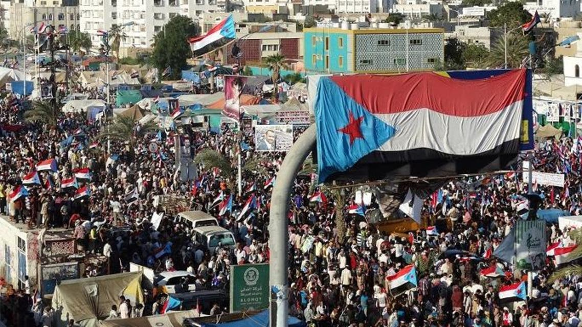 Yemani protesters wave flags and march through the streets during a demonstration demanding renewed independence in the southern city of Aden on Nov. 30, 2014. (AFP)