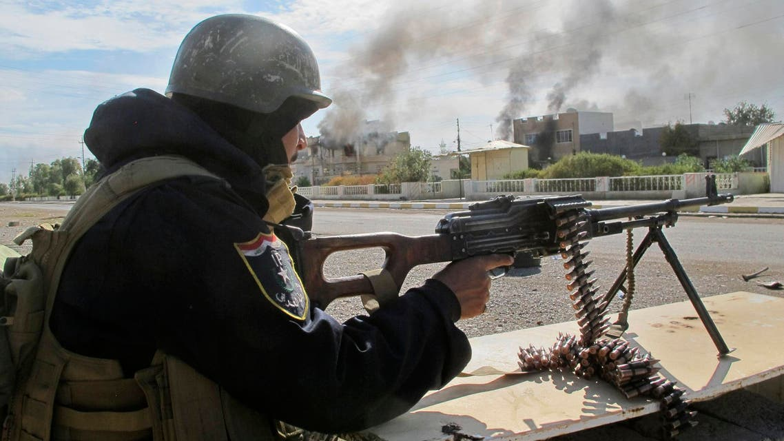 A member of the Iraqi security forces mans a gun during an intensive security deployment after taking control of Saadiya in Diyala province from Islamist State militants, November 24, 2014. (Reuters)