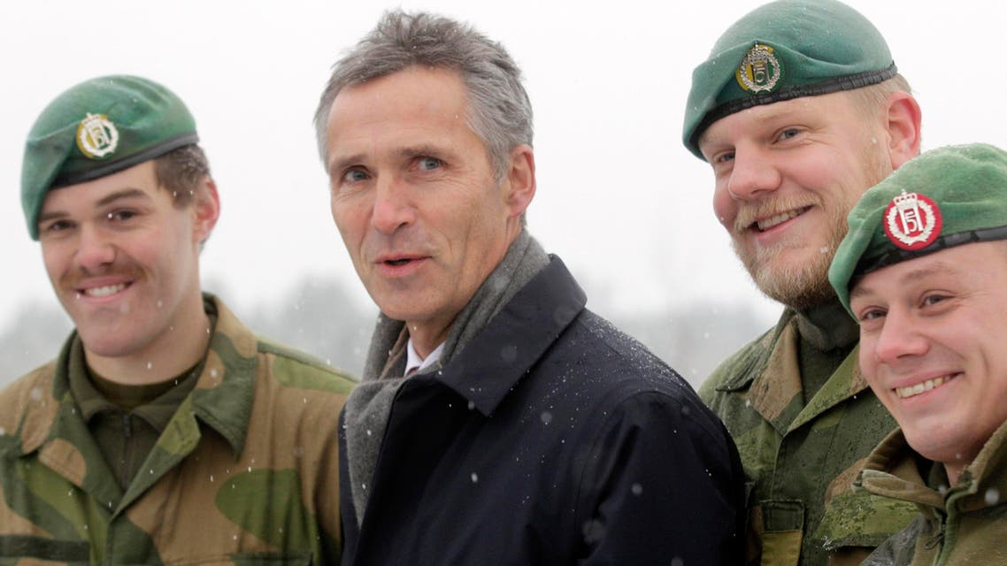 NATO Secretary General Jens Stoltenberg poses with Norwegian army soldiers deployed in Latvia at Adazi military base November 21, 2014.  (Reuters)