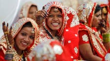 Indian tycoon throws mass wedding for fatherless women