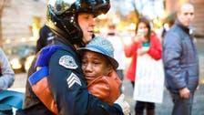 Photo of boy hugging officer at Ferguson protest goes viral