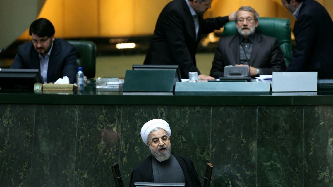 Iranian President Hassan Rouhani speaks during a parliament session in Tehran on November 26, 2014 to defend his nominee for the ministry of science, research and technology. (AFP)