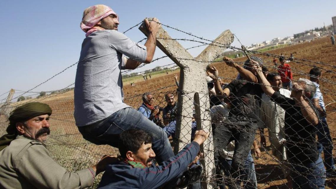 the refugees, living in their cars after fleeing the Islamic State of Iraq and Syria (ISIS) onslaught in Syria, were stuck in the minefield because Turkey had refused entry for vehicles and livestock