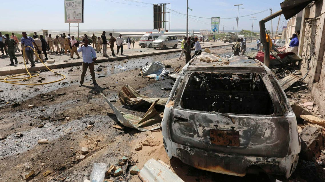 A wreckage at the scene of an explosion is seen in front of the airport in Somalia's capital Mogadishu, December 3, 2014. (Reuters)