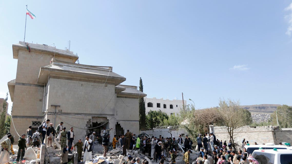 Police and onlookers gather at the damaged residence of the Iranian ambassador after a car bomb attack in Sanaa Dec. 3, 2014. (Reuters)