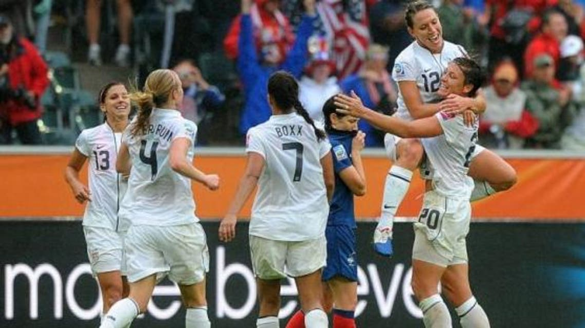 Lauren Cheney (2ndR), Abby Wambach (R) and teammates celebrate after their victory after the FIFA women's football World Cup semi-final match vs. France. (AFP)