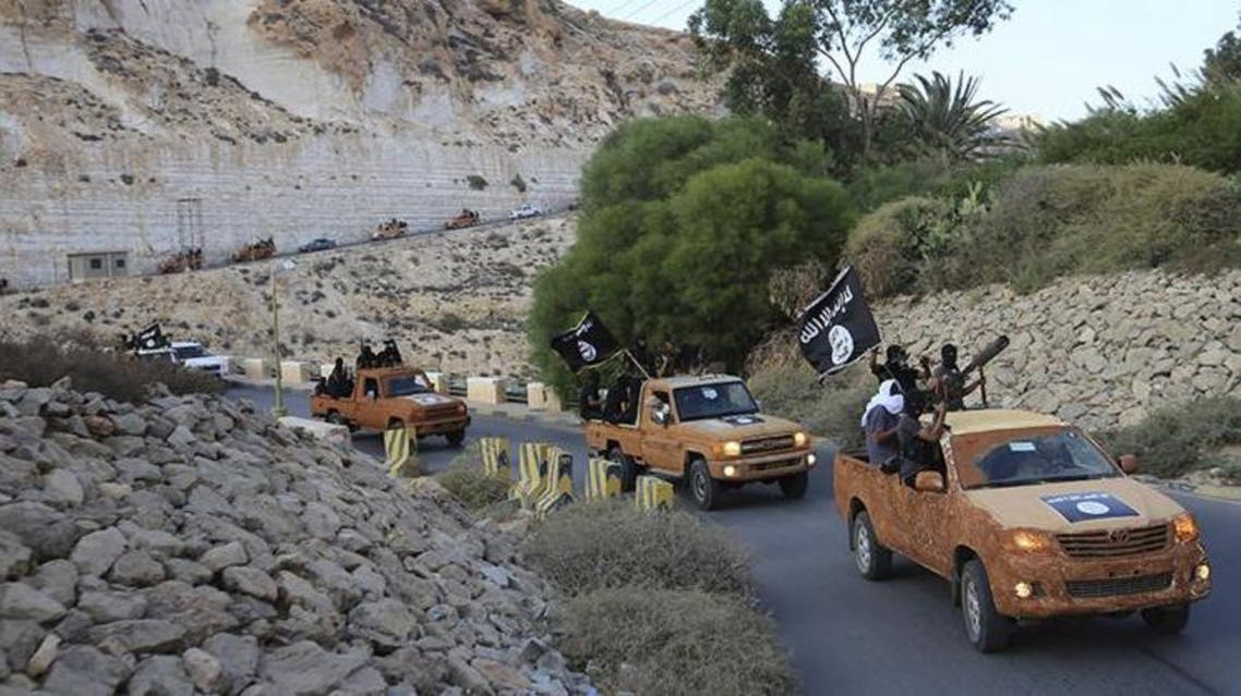 n armed motorcade belonging to members of Derna's Islamic Youth Council proceeds along a road in Derna, eastern Libya, Oct. 3, 2014. The group pledged allegiance to the Islamic State group fighting in Syria and Iraq.