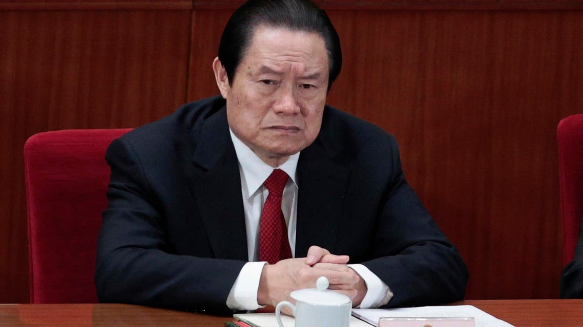 China's former Politburo Standing Committee Member Zhou Yongkang attends the closing ceremony of the National People's Congress (NPC) at the Great Hall of the People in Beijing in this March 14, 2012 file photo.  (Reuters)