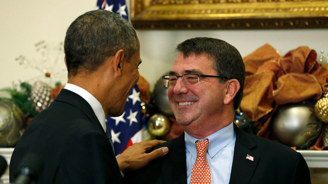 U.S. President Barack Obama puts his hand on the shoulder of former Pentagon official Ash Carter after nominating Carter to be his next defense secretary, at the White House in Washington Dec. 5, 2014. (AFP)