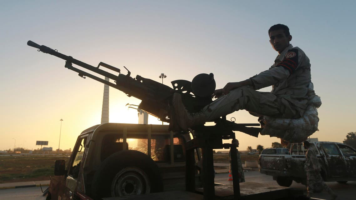 A Libyan military personnel mans a checkpoint in the city center in Benghazi December 4, 2014, where clashes between pro and anti-government forces have taken place. Reuters