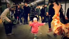 Little girl infects NYC subway with dance bug