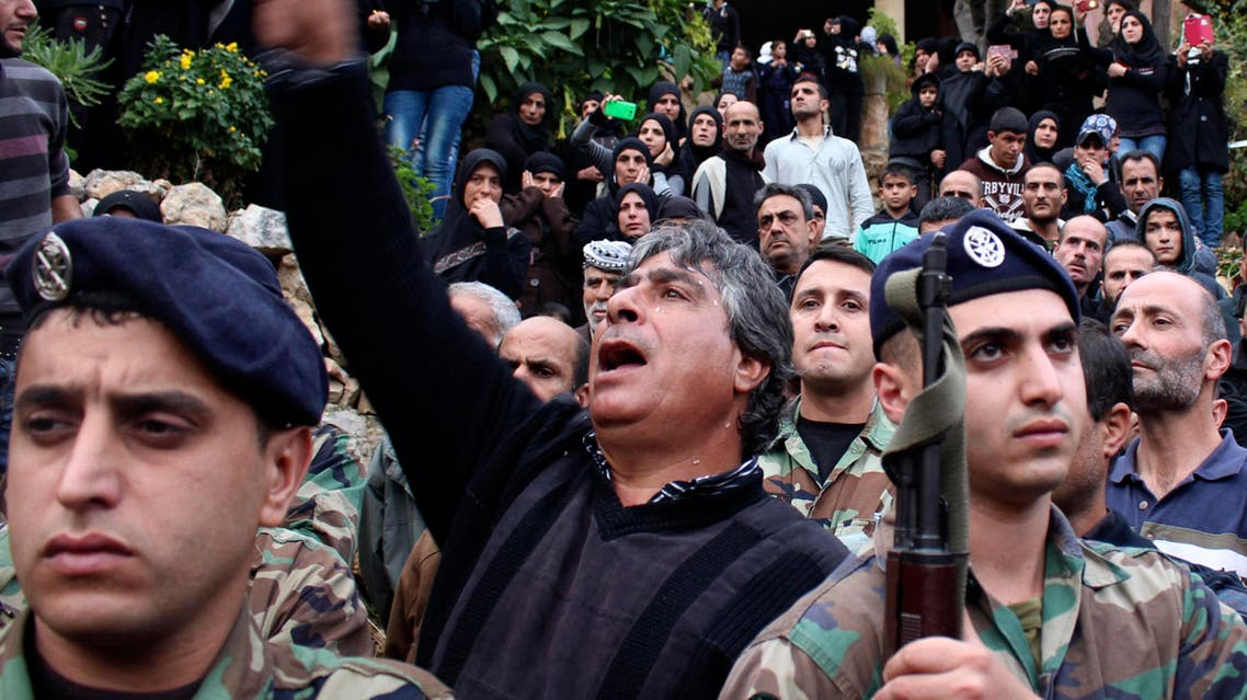 Lebanese army soldiers, friends and family members mourn for soldier Ali Mohammad, who was killed during an ambush in Ras Baalbek when gunmen killed at least six Lebanese soldiers, during his funeral in his hometown of Habshit in Akkar December 3, 2014. (File photo: AFP)