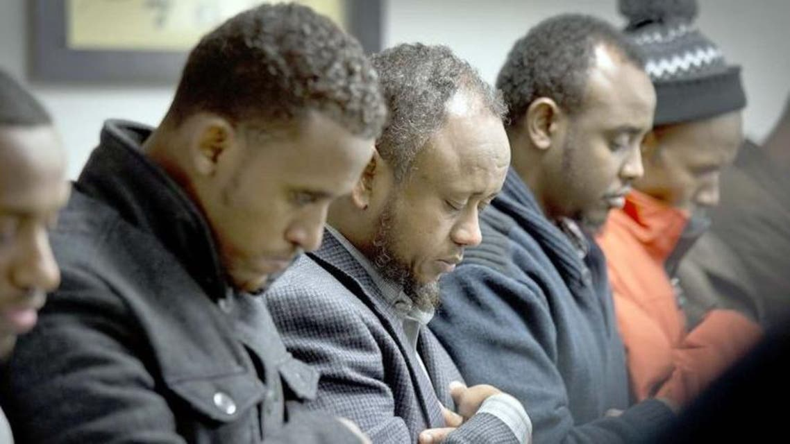 Men gather to pray the day after 15-year-old Abdisamad Sheikh-Hussein was struck and killed. (Photo courtesy: AP)