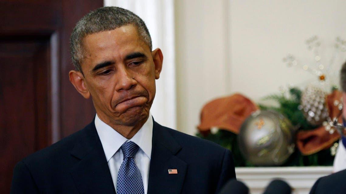 U.S. President Barack Obama listens to former Pentagon official Ash Carter speak after nominating Carter to be his next defense secretary, at the White House in Washington December 5, 2014. (Reuters)