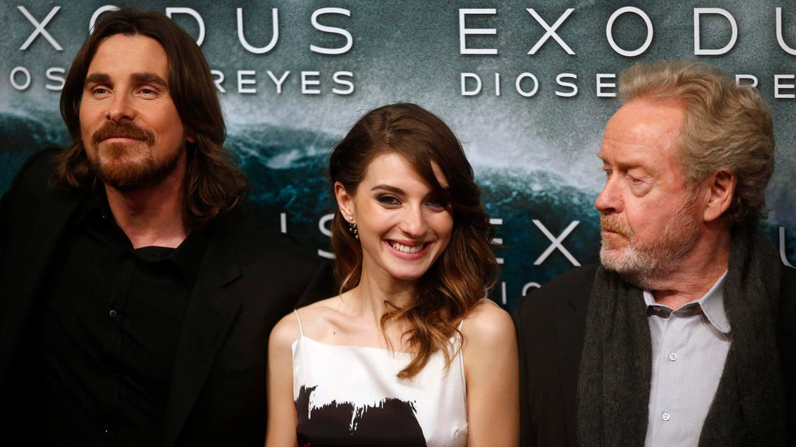 """Director Ridley Scott (R) and cast members Christian Bale and Maria Valverde (C) pose for photographs as he arrive for the film world premiere of """"Exodus: Gods and Kings"""" in Madrid , December 4, 2014. (Reuters)"""