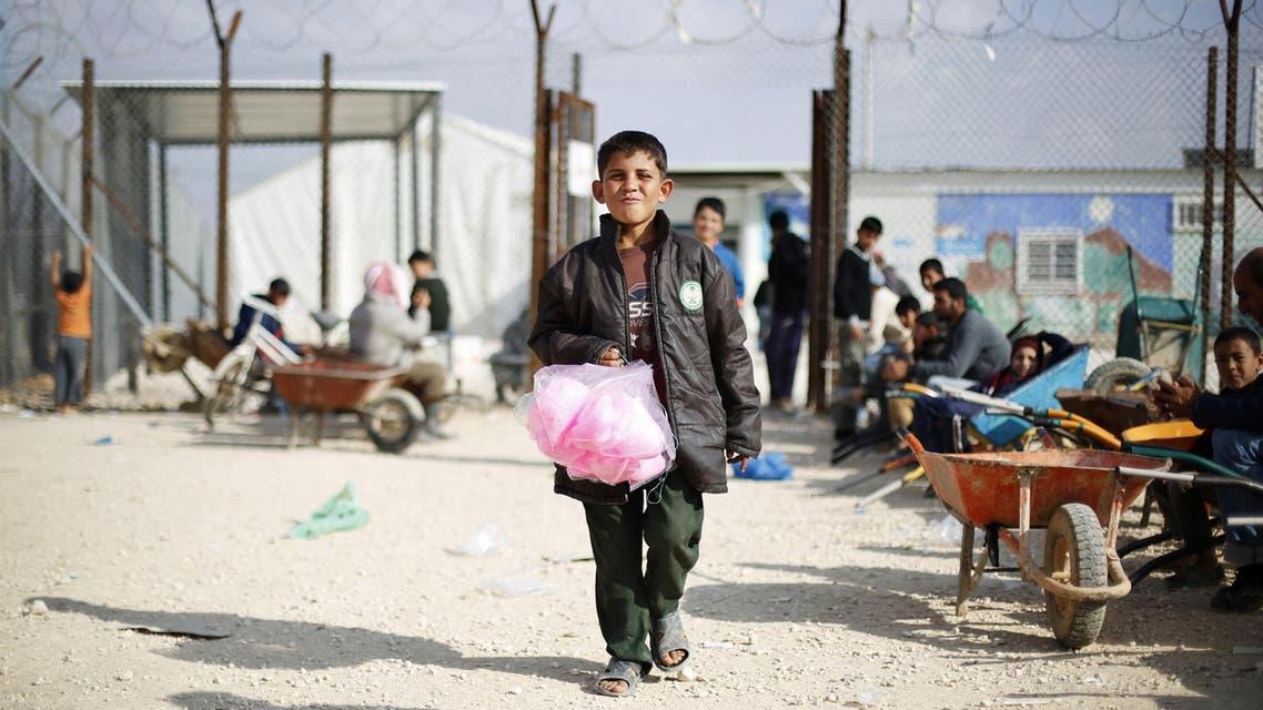 Syrian children at the Al-Zaatari refugee  camp in the Jordanian city of Mafraq