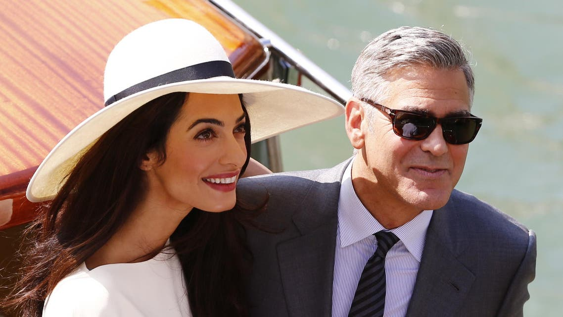 US actor George Clooney and British lawyer Amal Alamuddin leave the palazzo Ca Farsetti on a taxi boat on September 29, 2014 in Venice. (AFP)