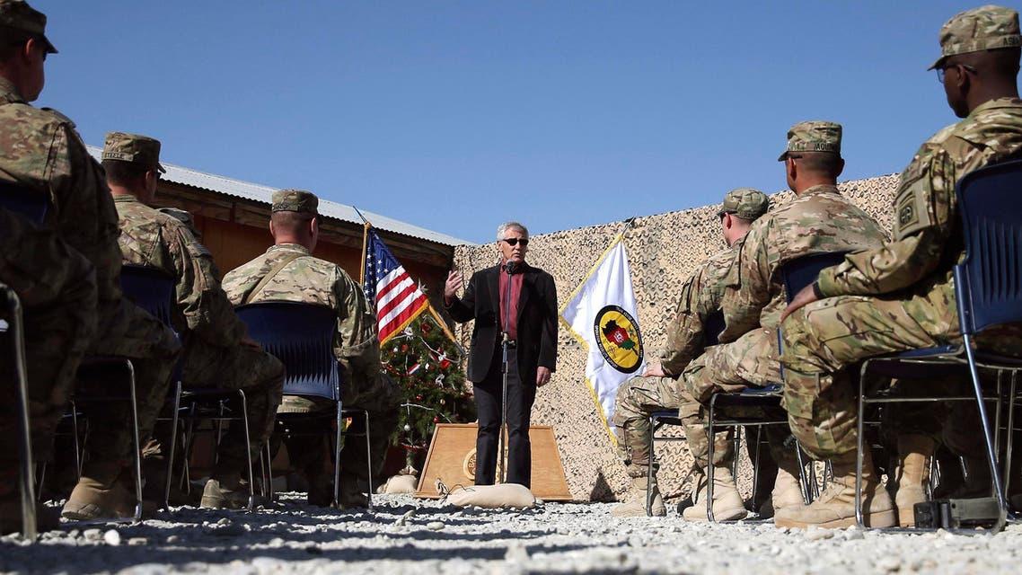 U.S. Defense Secretary Chuck Hagel speaks to American troops during a visit to Forward Operating Base Gamberi December 7, 2014. (Reuters)