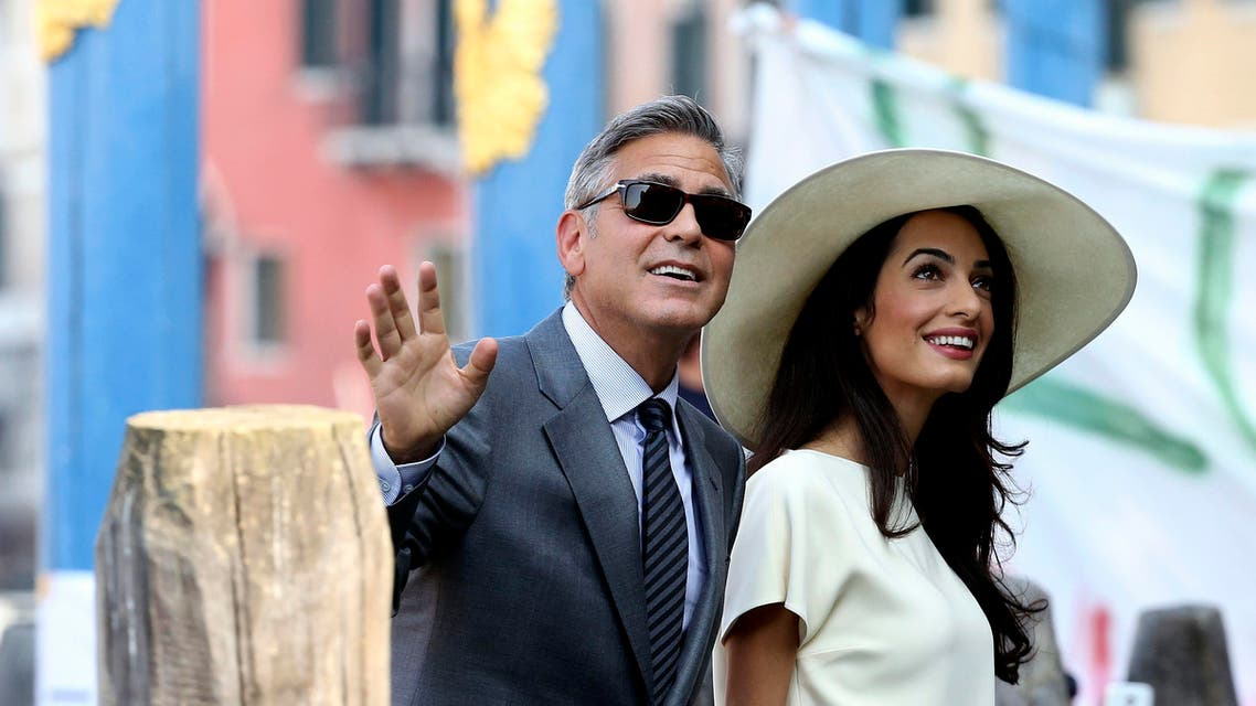 U.S. actor George Clooney and his wife Amal Alamuddin arrive at Venice city hall for a civil ceremony to formalise their wedding in Venice, in this September 29, 2012. (Reuters)