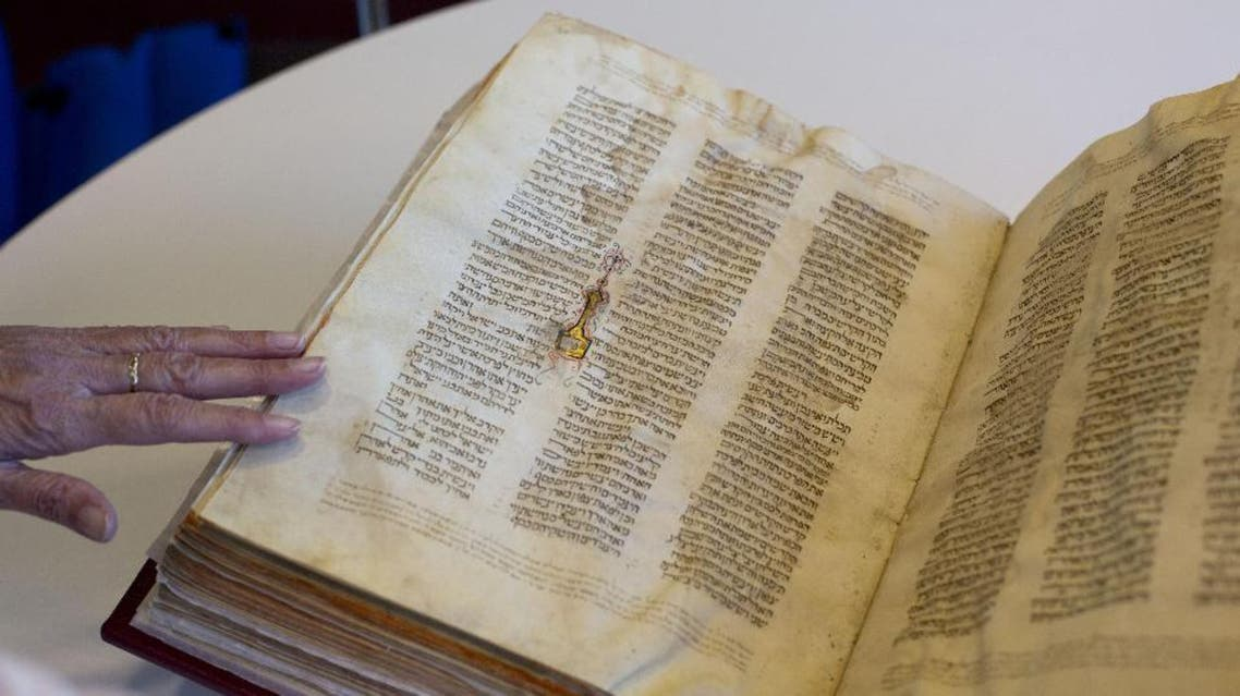 A library official shows a Jewish manuscript smuggled into Israel from Damascus in a Mossad spy operation in the early 1990s. (File photo: AP)
