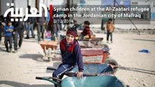 Syrian children at the Al-Zaatari refugee  camp in the Jordanian city of Mafraq