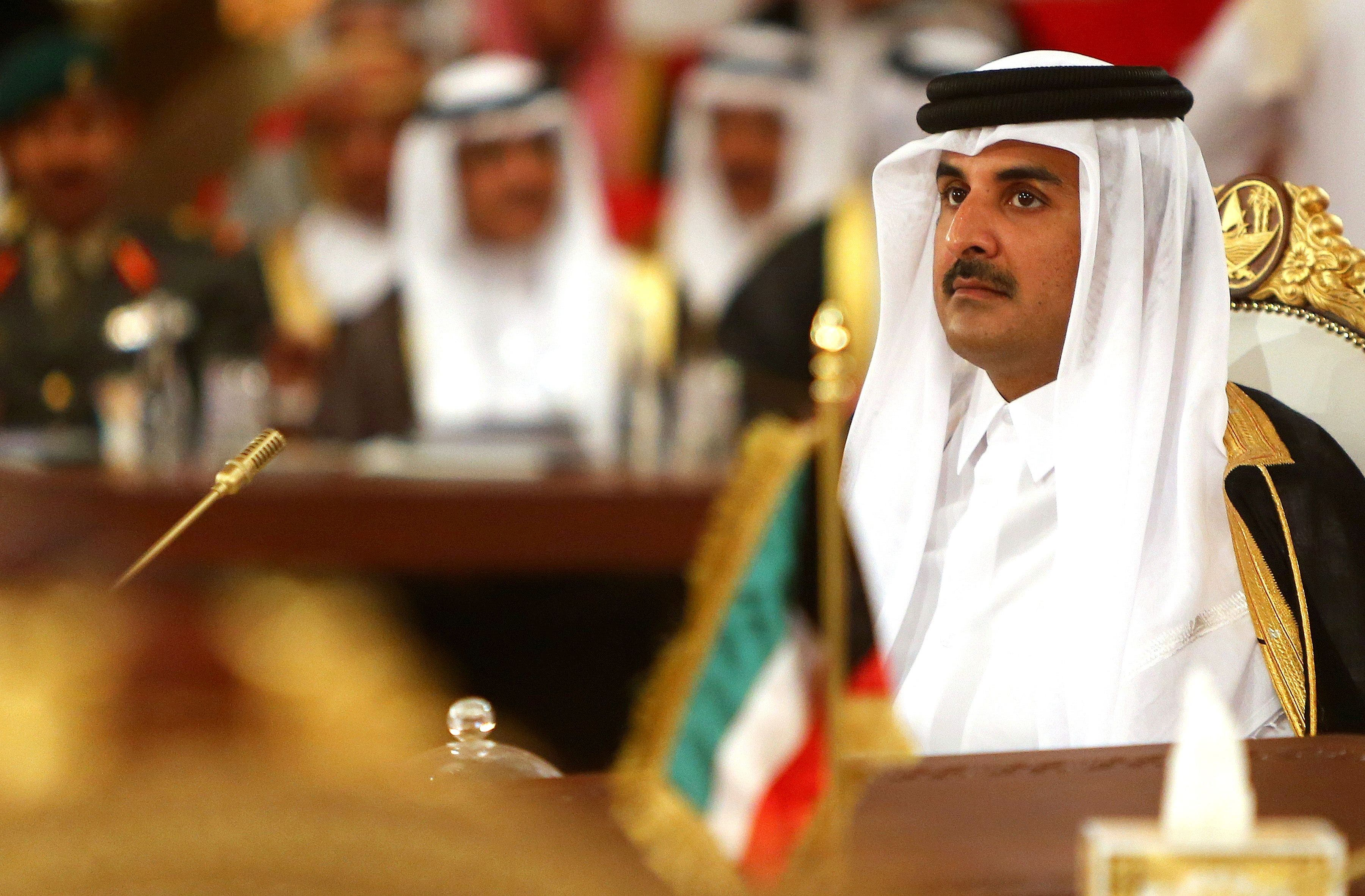 Qatar's Emir Sheikh Tamim bin Hamad Al-Thani looks on during the Gulf Cooperation Council (GCC) summit in Doha on December 9, 2014. (AFP)