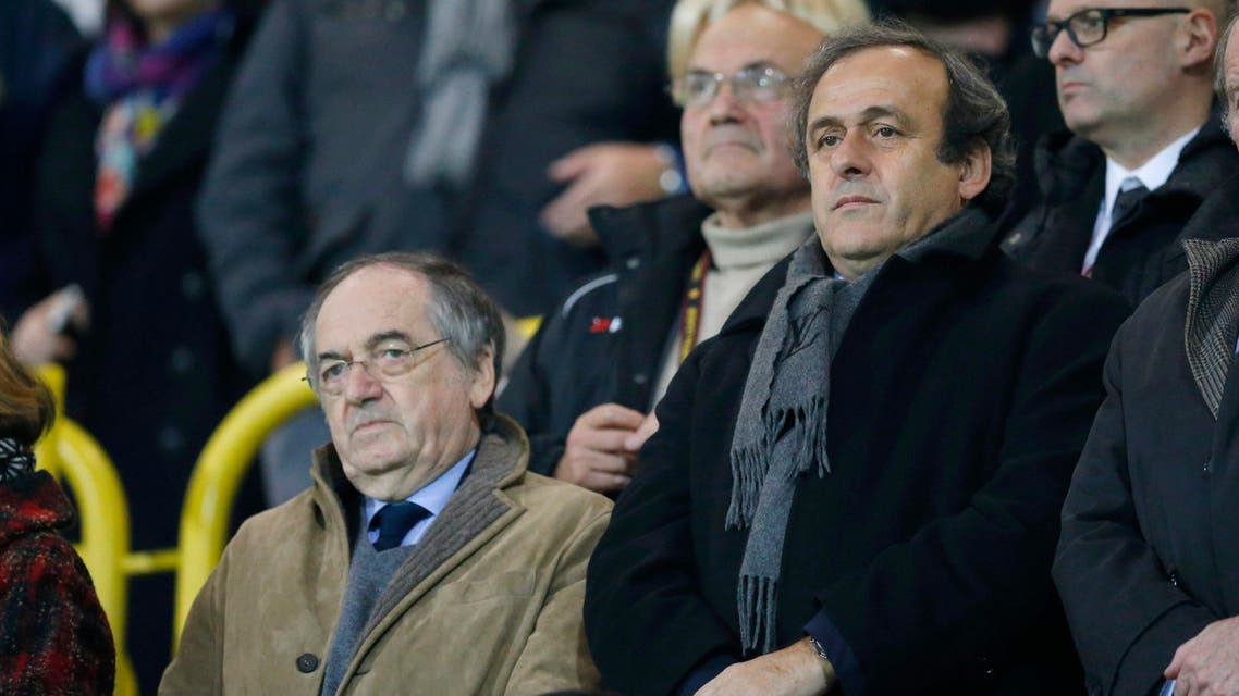UEFA President Michel Platini (R) and French Football Federation (FFF) President Noel Le Graet attend the Europa League Group K soccer match between Guingamp and Fiorentina at the Roudourou stadium in Guingamp, November 27, 2014.  reuters