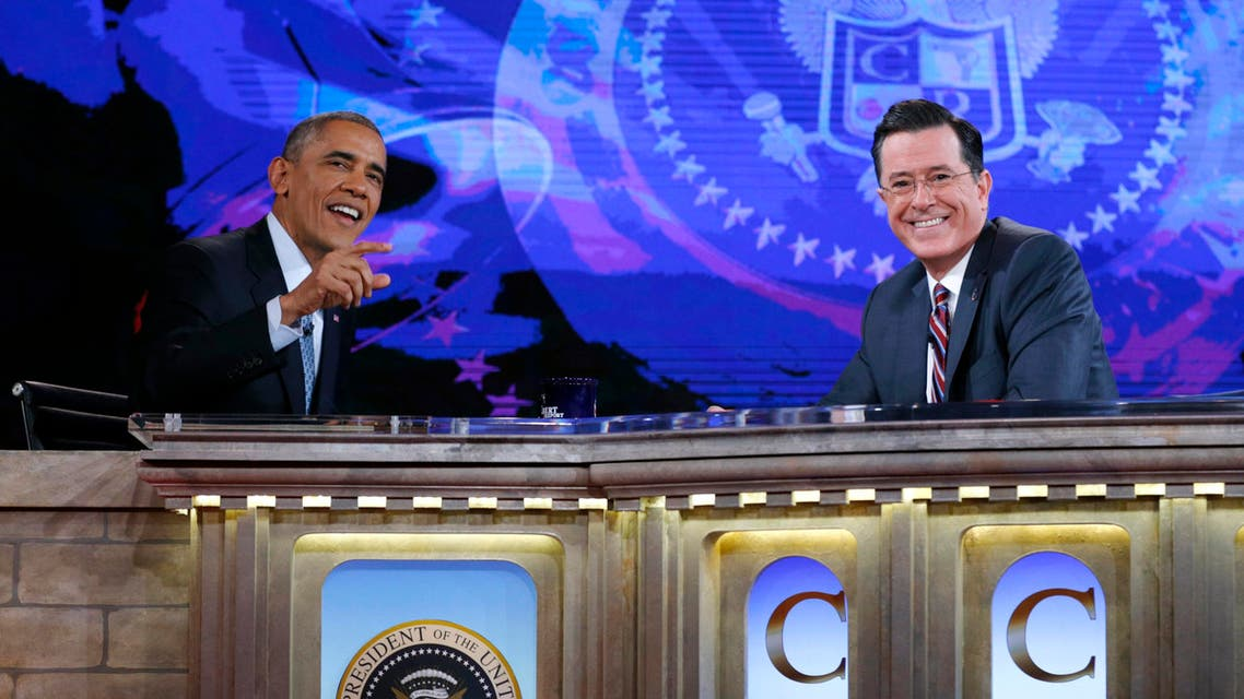 U.S. President Barack Obama (L) appears on The Colbert Report with Stephen Colbert at the Lisner Auditorium at George Washington University in Washington December 8, 2014. Reuters